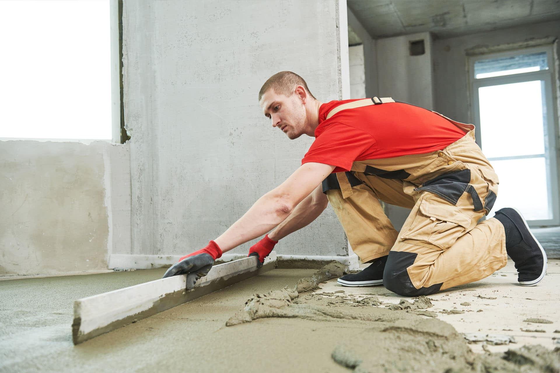 cement-man-screeding-base-layer-flooring-building-materials