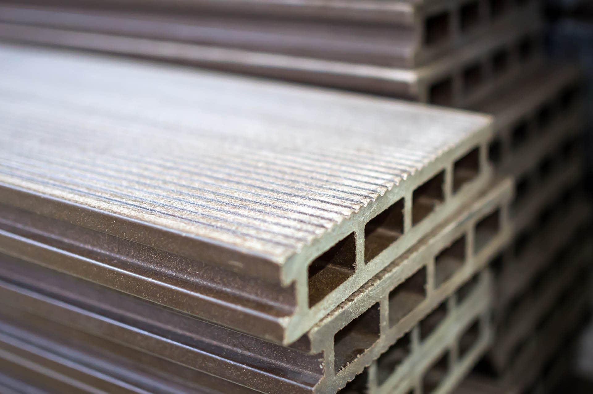 Composite decking polymer board stacked - Composites Alternatives