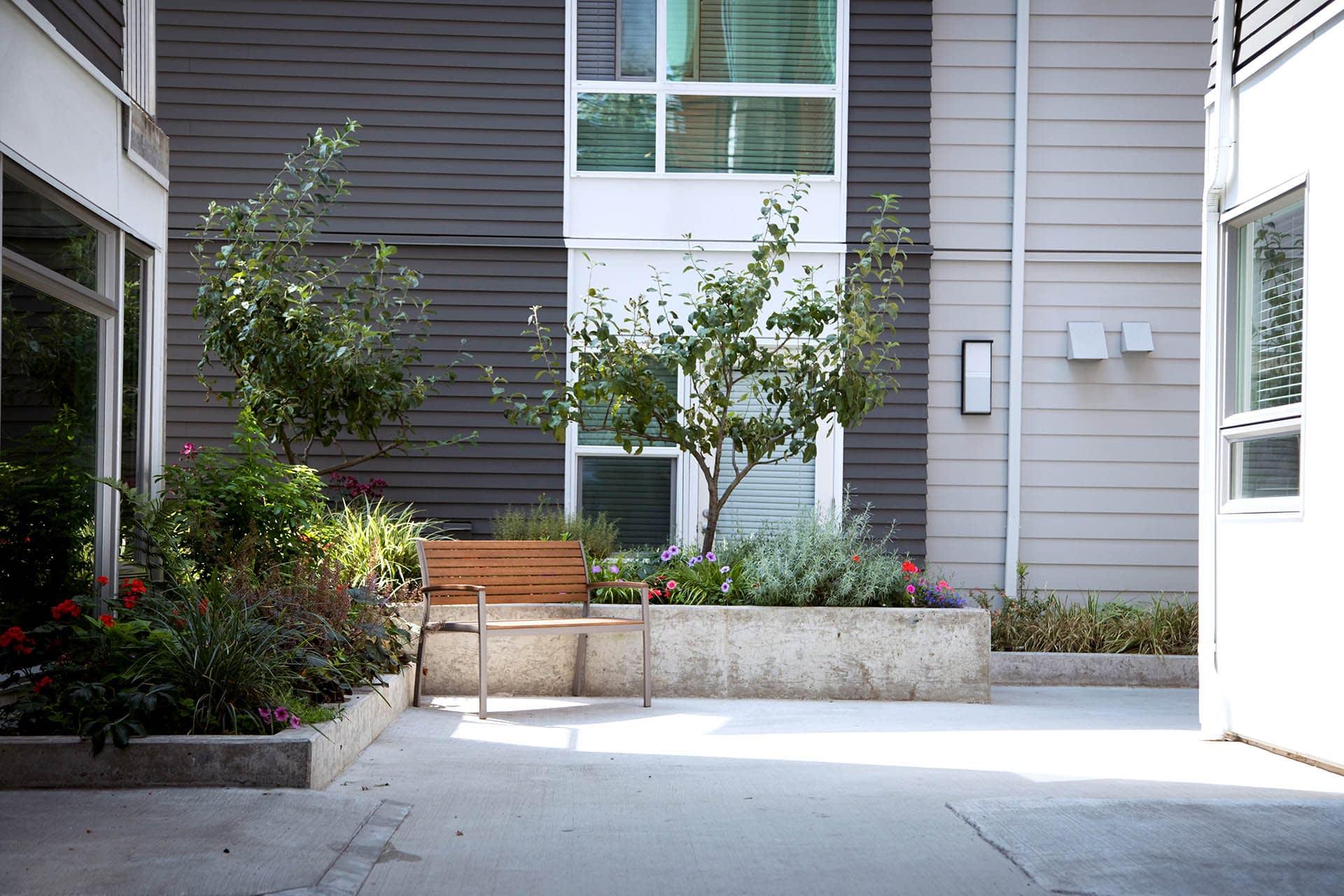 Composite Cladding on modern landscaped building - Composites Alternatives