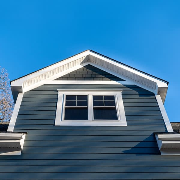 New restoration facade with Composite Cladding blue vinyl siding - composites alternatives