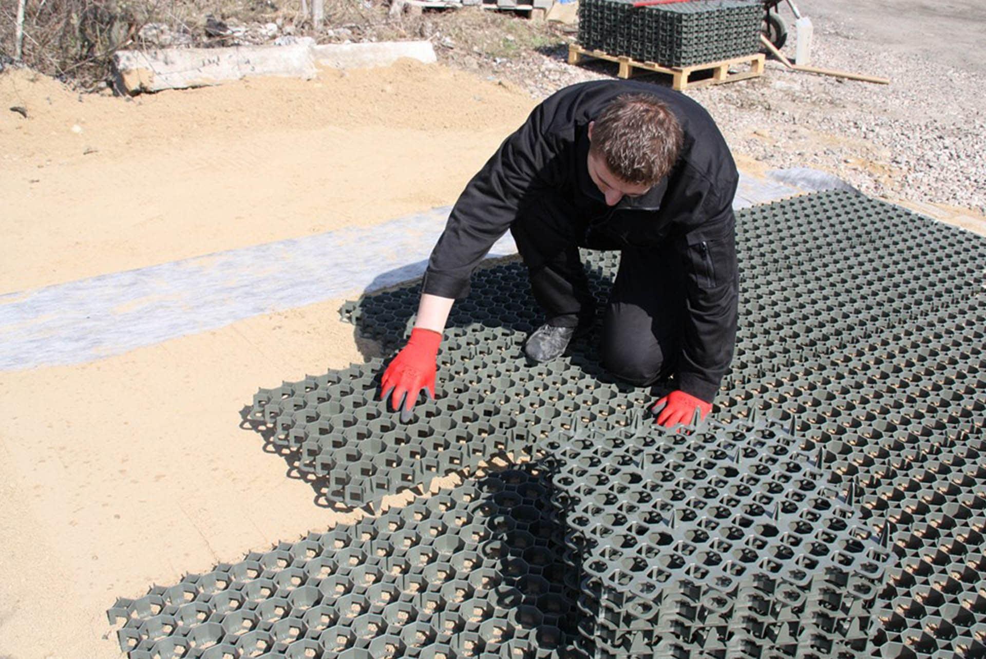 elite-grass-grid-composite-alternative-ground-reinforcement-stabilisation-installation-man