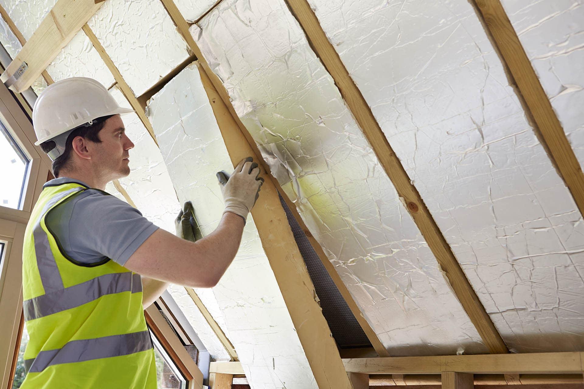 Builder installing block insulating board sheets - building materials