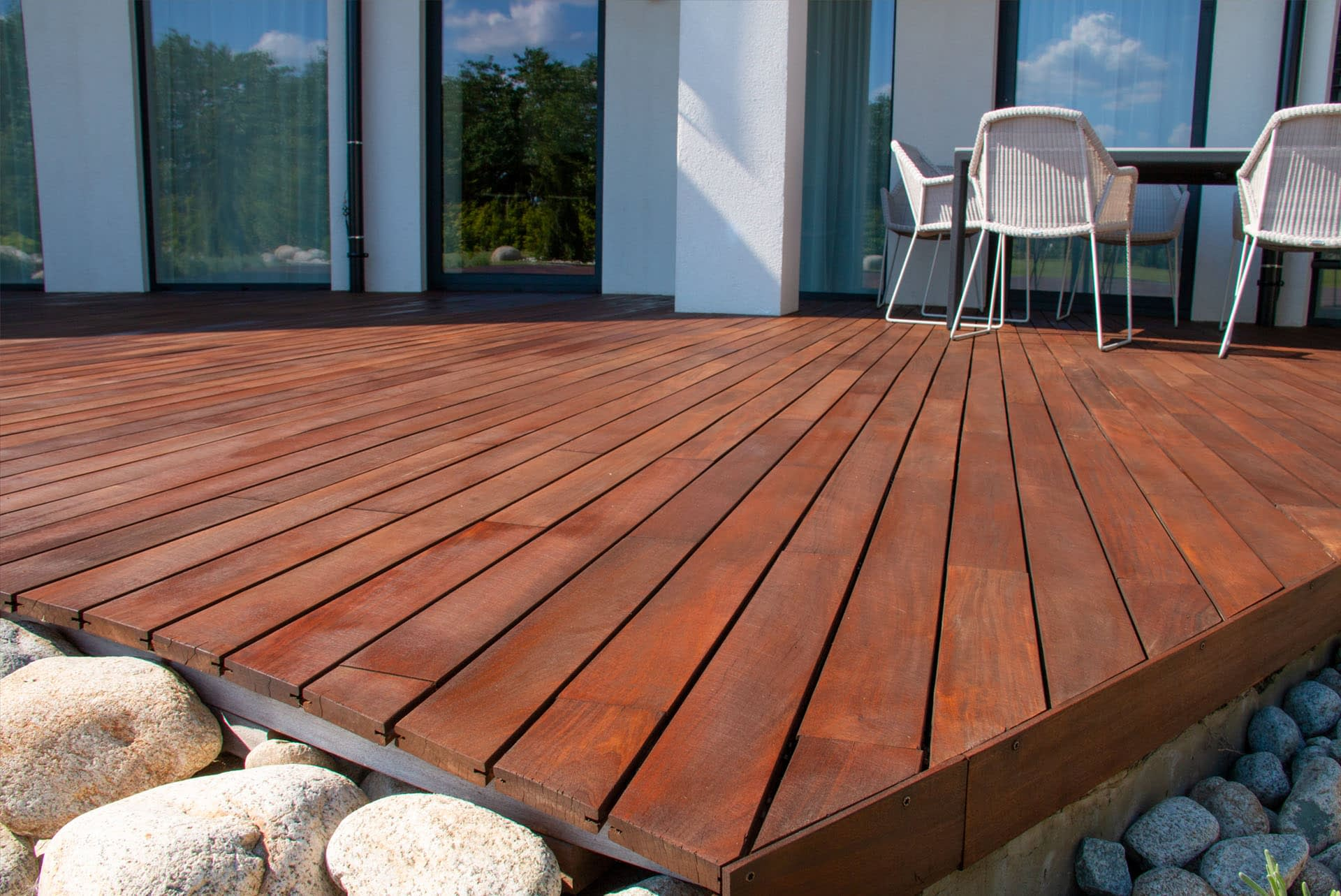 Timber Decking wooden deck boards hardwood pressure treated smooth dark wood patio